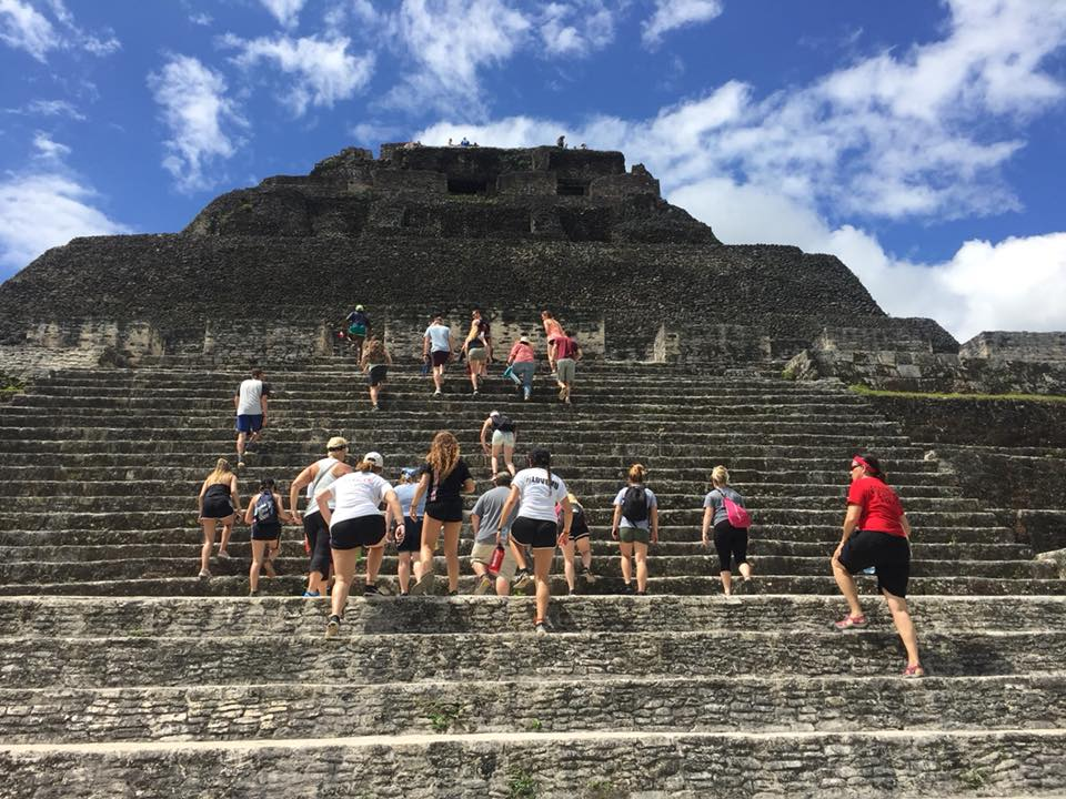 Students visiting historic site in Belize