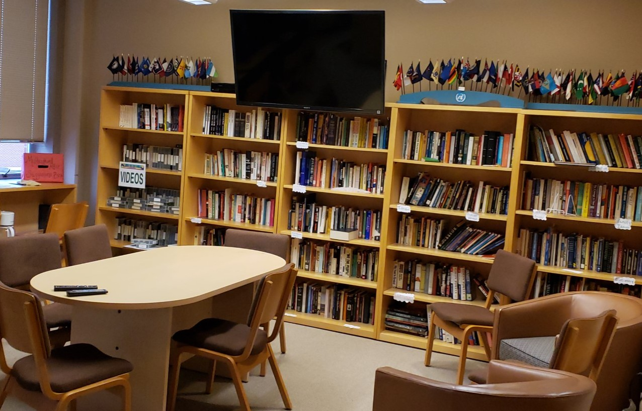 Inside of the Martin Luther King Jr Center, with bookshelves, chairs, and TV