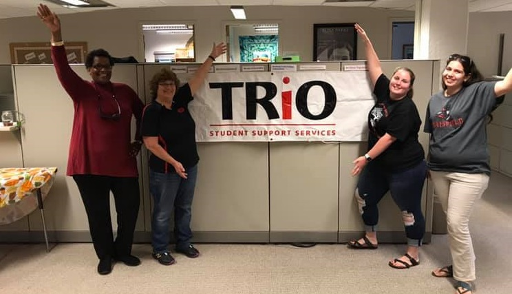 TRiO Staff with TRiO Banner