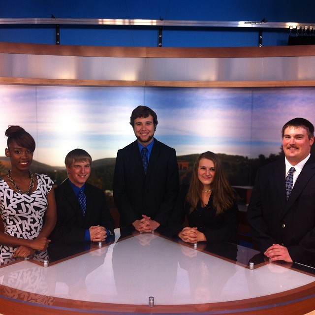 Students at the MUTV anchor desk