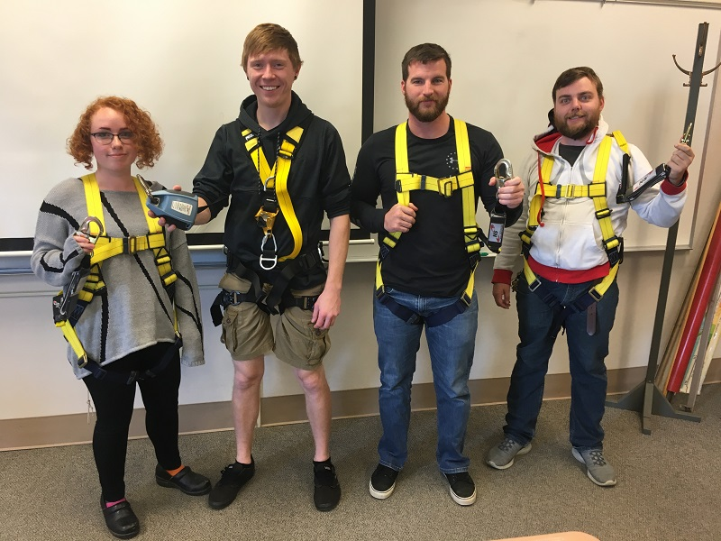 Students in safety harnesses
